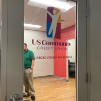 US community credit window logo sign